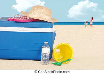 beach cooler with hat bottle water - closeup beach cooler...