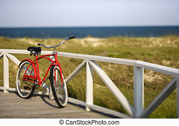 Beach cruiser bicycle. - Bicycle leaning against rail on...
