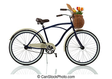Beach cruiser with basket that has tulips and bread in it