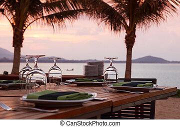 Beach dinner serving at sunset