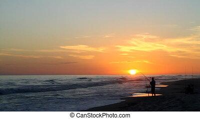 Beach Fisherman At Sunset