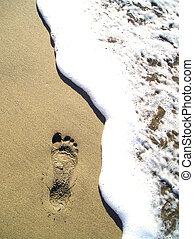 Beach Footprint - Footprint in the sand with wave
