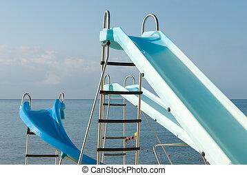 Beach fun equipment - Several slides under the sun, waiting ...
