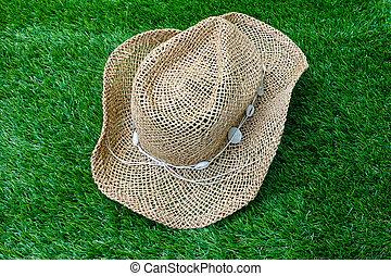 Beach hat on green grass