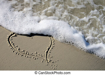 Beach Heart - Heart on sand beach being washed away by sand