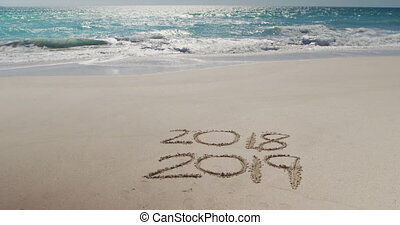 Beach holiday destination - 2018 and 2019 written in the ...