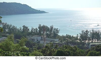 Beach hotel and distant boats in the sea. Phuket, Thailand...