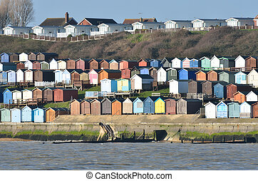 Beach hut and houses and Walton-on-Naze
