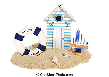Beach hut with sailing boat and life buoy