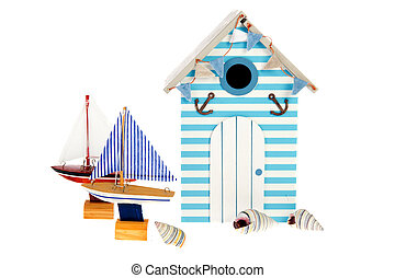 Beach hut with sailing boats
