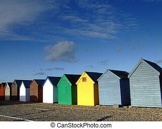 beach huts in a small coastal town