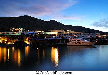 Beach illumination at luxury hotel during sunset, Crete, Greece