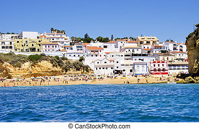 beach in Carvoeiro town with colorful houses on coast of Portugal