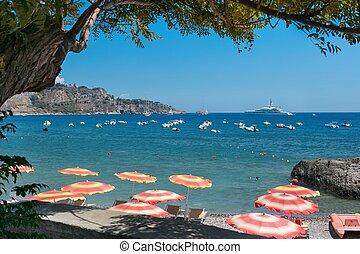 Beach in Giardini Naxos, Sicily - Giardini Naxos, ITALY -...