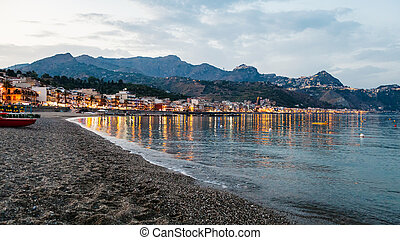 beach in Giardini Naxos town in summer evening - travel to...