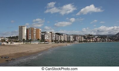Beach in Malaga, Spain - Waterside buildings of La Caleta...