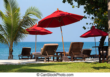 Beach in Thailand. - Umbrella and chairs on the beach on ...