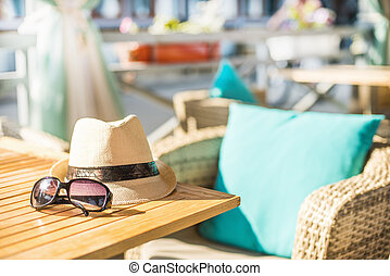 Beach items with straw hat