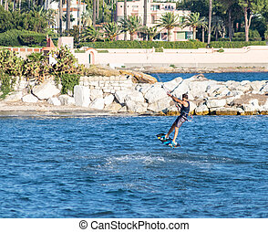 Beach Juan les Pins, French Riviera, France, Kitesurfeur flying above the waves