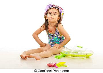 Beach kid girl with toys