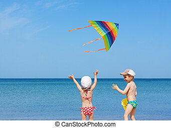 beach  kite children siblings play fun together