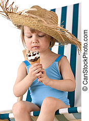 Beach - Little girl on deck-chair with hat and ice-cream