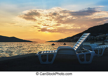 Beach lounge chairs - Empty plastic beach lounge chairs with...