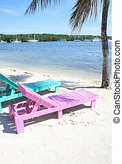 Beach lounge chairs - Colorful beach lounge chairs on the...