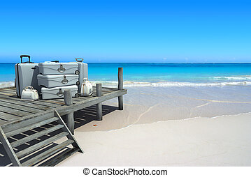 Beach luxury travel - A pile of luxurious luggage standing...