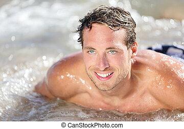 Beach man having fun in water