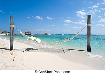 Beach nap - A hanging hammock, on a beach resort