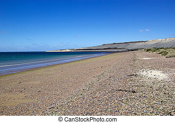 Beach near Puerto Madryn, a city in Chubut Province In Patagonia, Argentina. Puerto Madryn is protected by the Golfo Nuevo, which is formed by the Peninsula Valdes and the Punta Ninfas