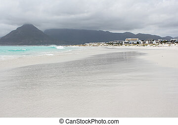 Beach of Kommetjie with an upcoming storm in the background ...