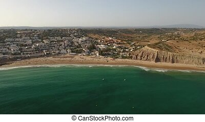 Beach of Praia da Luz at morning, Lagos, Algarve, Portugal aerial view