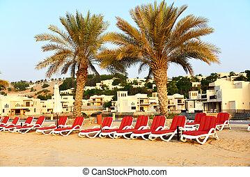Beach of the luxury hotel during sunset, Ras Al Khaima, UAE