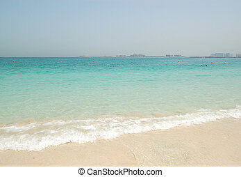 Beach of the luxury hotel with a view on Palm Jumeirah man-made island, Dubai, UAE