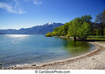 Beach on a lake with mountains