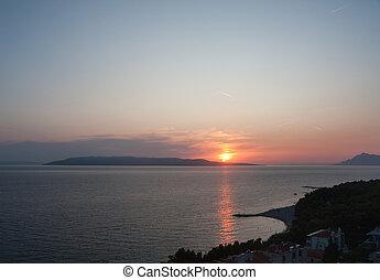 Beach on the sea at sunset
