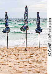 Beach parasol - The parasol on the beach, sand beach