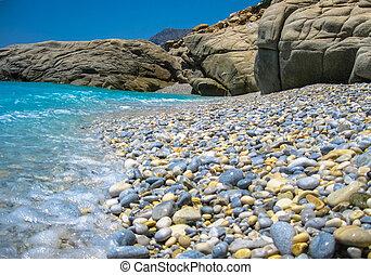 Clourful pebbles on a rocky beach