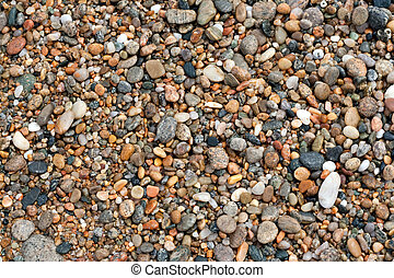 Beach Pebbles - A close up view of wet pebbles and stones...