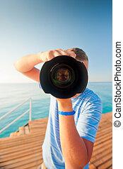 beach photographer with a large camera closeup
