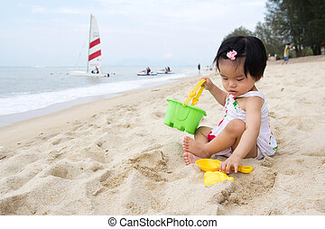 Beach playtime - Happy little baby girl playing sand on ...