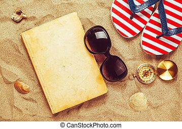 Beach ready, summer holiday vacation accessories on sandy beach