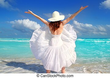 beach rear woman wind shaking white dress tropical turquoise...