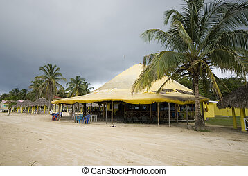 picnic center beach caribbean corn island nicaragua central america with restaurant and hotel