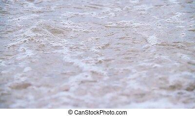 Waves on beach rocks