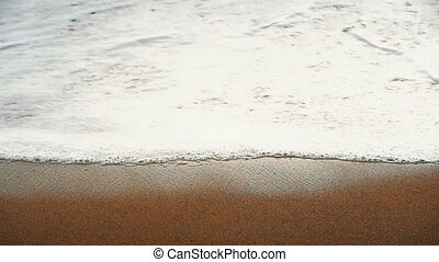 beach sand sea slow motion