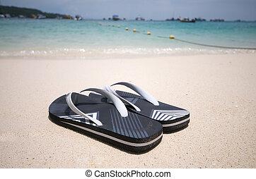 Beach Sandals - A pair of sandals on the beach