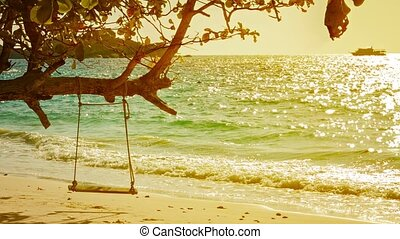 Beach, sea and ship. Beautiful tropical landscape with swing